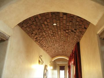 Brick ceiling in the arched hallway.
