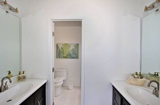 Mission Beach house photo - Master bathroom with his and her vanities.