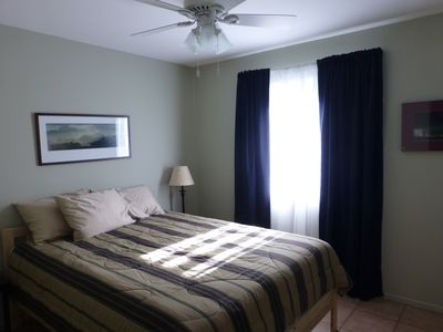 Queen size bed, quality sheets, light-blocking drapes and ceiling fan