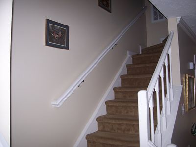 Twelve carpeted steps lead upstairs to two bedrooms & bathrooms.