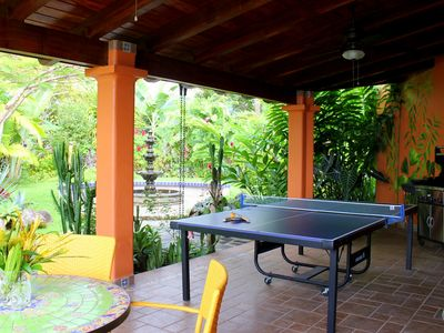 Veranda with ping-pong table and grill, another gathering spot for family fun
