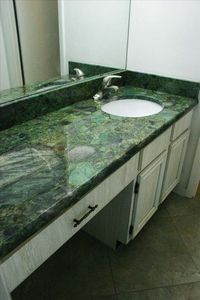 New exotic granite vanity in dressing room of master bath