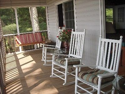 Cabin's spacious screened porch faces fabulous views.