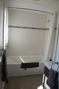 6ft soaking tub in master bathroom.