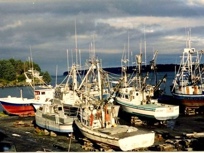 A view from the house, fishing vessels in the boatyard during sunet