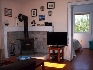 Provincetown condo photo - Living room with wood burning stove, 32 inch television and Ipod docking station