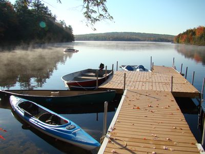 Dock with canoe, kayak, paddle boat, fishing boat, swim platform, water tramp