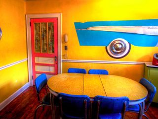 Tybee Island cottage photo - Meals on Wheels dining room with 57 chevy on the wall. How fun!