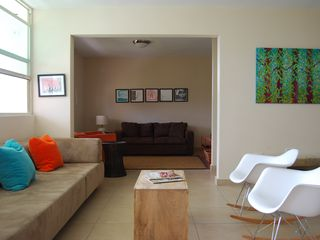 Aguadilla apartment photo - View of both living and entertainment rooms. The dark brown sofa has a full bed.