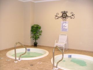 Fort Morgan condo photo - Relaxing in one of Several Hot Tubs on the Property....Wonderful!