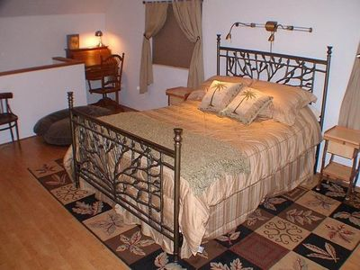 The entire upstairs is one large room with a queen bed