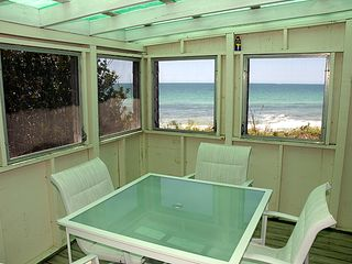 Siesta Key house photo - a campy beach front screened porch for meals, games, quiet reflection...