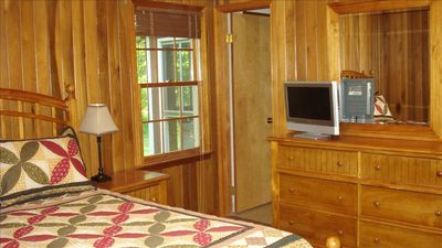 Solid wood furnishings and paneling in the master bedroom. TV w/ satellite.