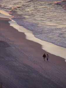 Pelican Beach condo rental - Early morning romantic walks on the beach. Photo taken from our balcony!