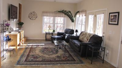 Beautiful open living room with 42' flat screen, DVD, VCR, Wireless Internet