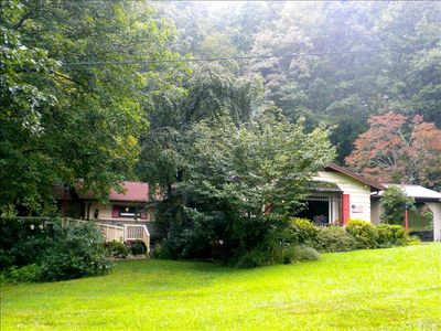 5 acre mountain home on Ghost Town Mountain with beautiful yard and view.