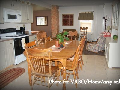 Spacious eat-in kitchen with adjoining family room and breakfast table.
