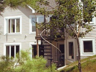 Bar Harbor house photo - Back of home facing sunny east with up stairs deck and patio below