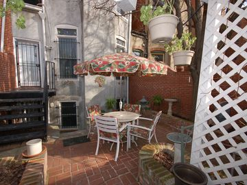 Quiet rear patio offers a great place to enjoy morning coffee and breakfast