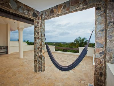 Third floor terrace with hammock and ocean and jungle views.