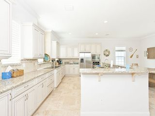 Palm Coast house photo - 2nd Floor Kitchen with Bosch appliances, stone countertops