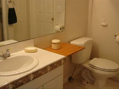 Upper Bathroom with Tub, Shower, Single Sink & Linen Closet.