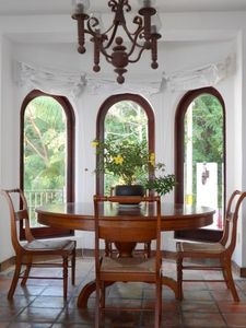 Dining room with lovely view of garden and jungle.