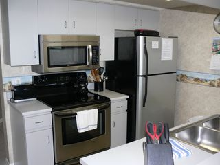 Cocoa Beach condo photo - Kitchen: full size s/s appliances including glasstop range, refrigerator + micro