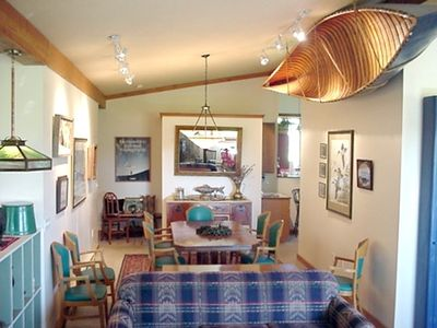 Craig lodge rental - Dining room is decorated with antique boats, antiques, local art.