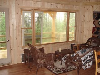 Salon looking out to woods - Franklin cabin vacation rental photo