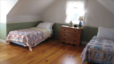 Upstairs bedroom with two single beds and lots of room