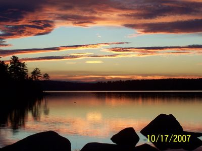 Peaceful Sunset over Great Moose Lake from Lakefront Deck Chairs and Fire Pit