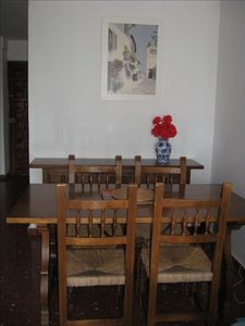 Dining area with classic Spanish table and chairs for six.