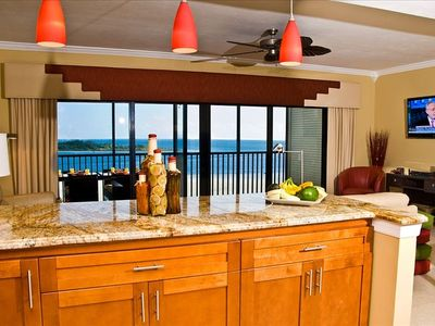 Gulf of Mexico views from  kitchen. Designer cornice board, double glass doors .
