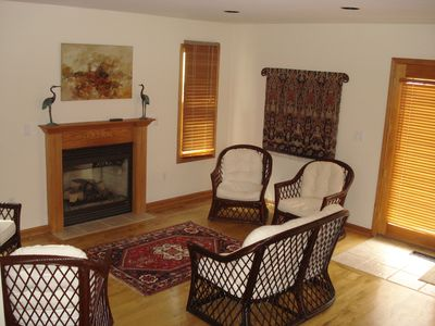 The Conversation/Library Room with gas fireplace