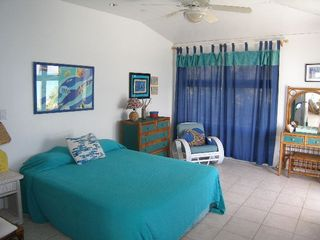 Elbow Cay and Hope Town villa photo - First guest bdrm. facing the ocean. Note tile throughout home.