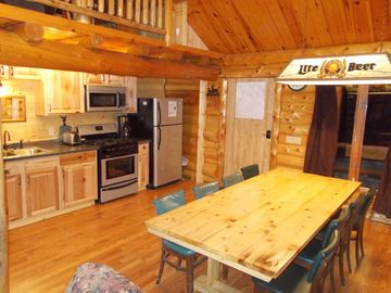 The updated kitchen is beautiful! The long kitchen table seats 10 people.