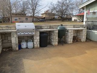 Kingsland house photo - Cooking area off patio including large gas grill and Big Green Egg!!!