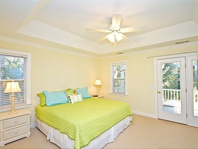 Master Bedroom with door leading out to upper porch  with Palm tree's View