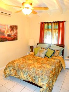 3rd bedroom includes Queen bed, ceiling fan and AC and garden views