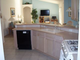 Orange Tree house photo - Large kitchen overlooking breakfast nook / family room areas & dining room too