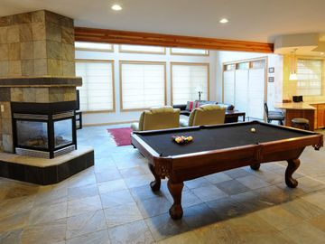 Pool Table and three sided gas fireplace