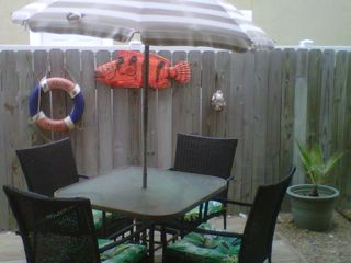 Back deck patio area. Sit & enjoy your morning coffee (Smoking is allowed here) - Corpus Christi condo vacation rental photo