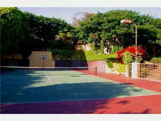 Malibu house photo - Tennis/ basketball court and extra parking.