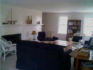 Hyannis - Hyannisport house photo - sunny, large living room with TV, fireplace.