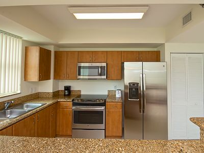 Fully equipped kitchen with brand new stainless steel appliances.