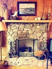 Apalachicola cabin photo - extraordinary fireplace made with river stones.