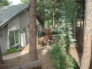 Flagstaff house photo - Backyard patio, BBQ and steps from forest land