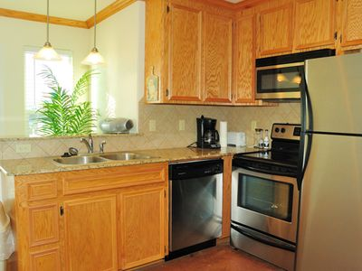 Granite counters & stainless appliances in fully stocked kitchen