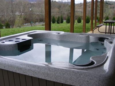 Hot tub with waterfall and LED colorchanging lights